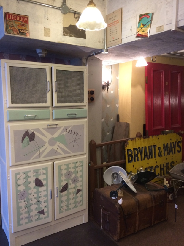 Painted cupboard, antique trunk and signs