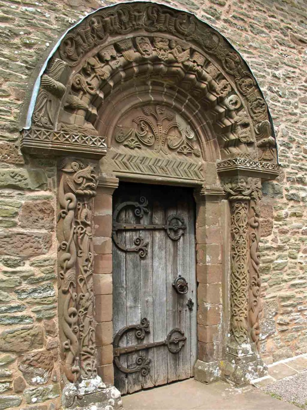 Arched church door with carvings