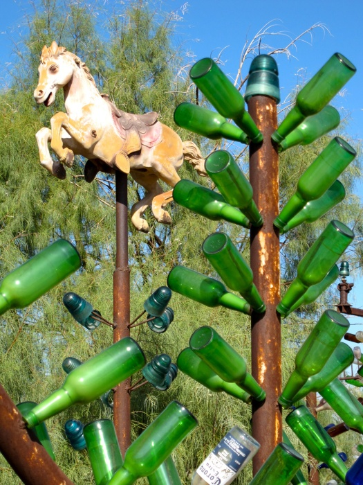 Bottle tree capped with a rocking horse
