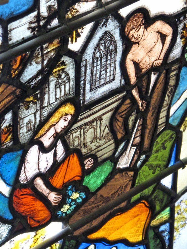 Stained glass showing Adam and Eve