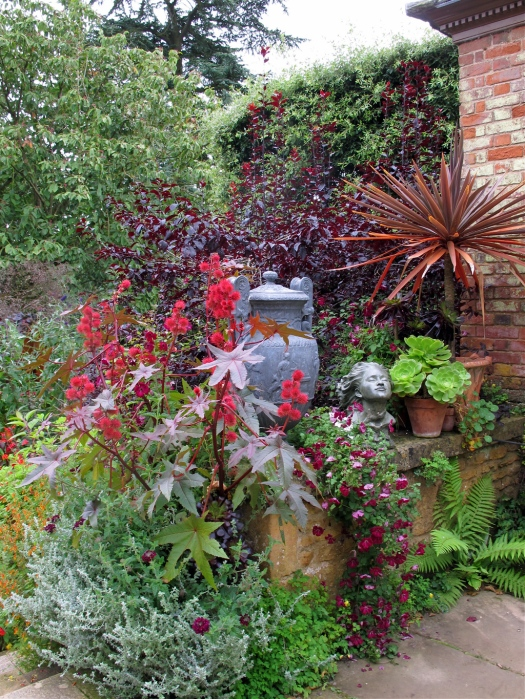 Pots, urns, flowers and a sculpted head