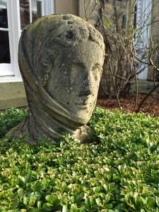 Stone head encased in box topiary