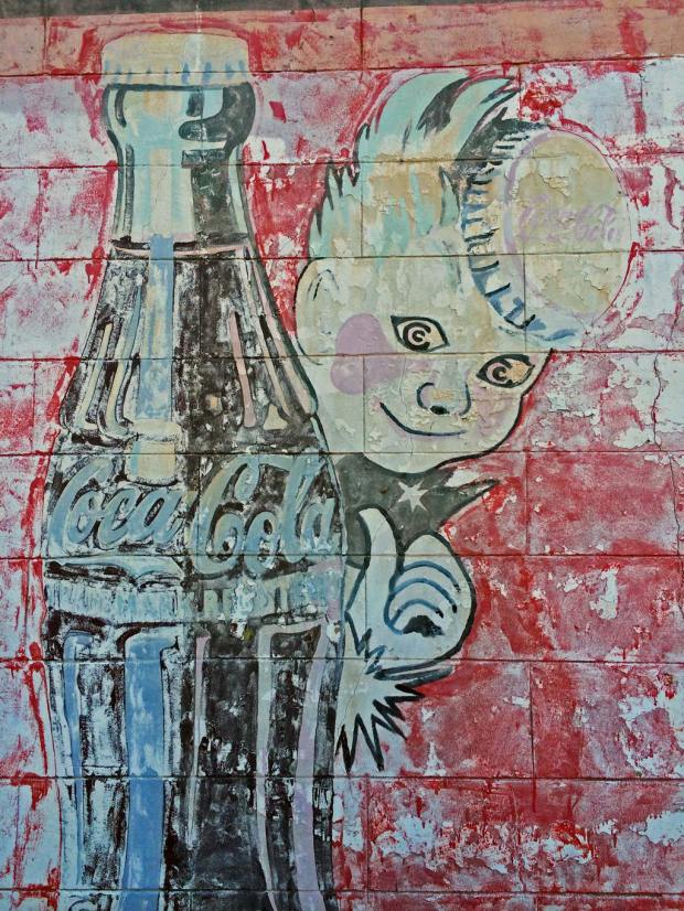 Faded Coca-cola advertising mural with the Sprite Boy at Vicksburg, ms