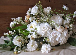 A bouquet of white garden roses with lily of the valley