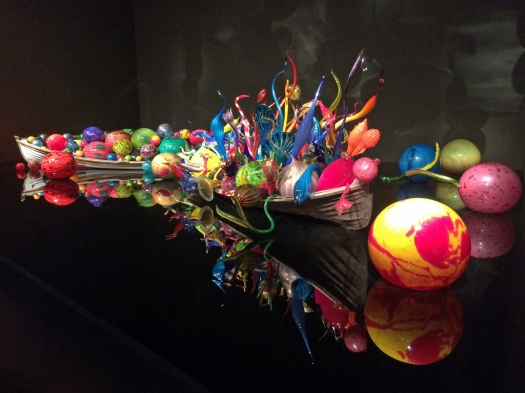 Chihuly art glass boats on a mirror
