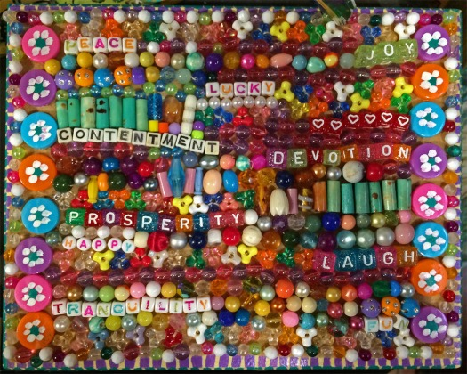 Peace, contentment, prosperity, tranquility written in beads