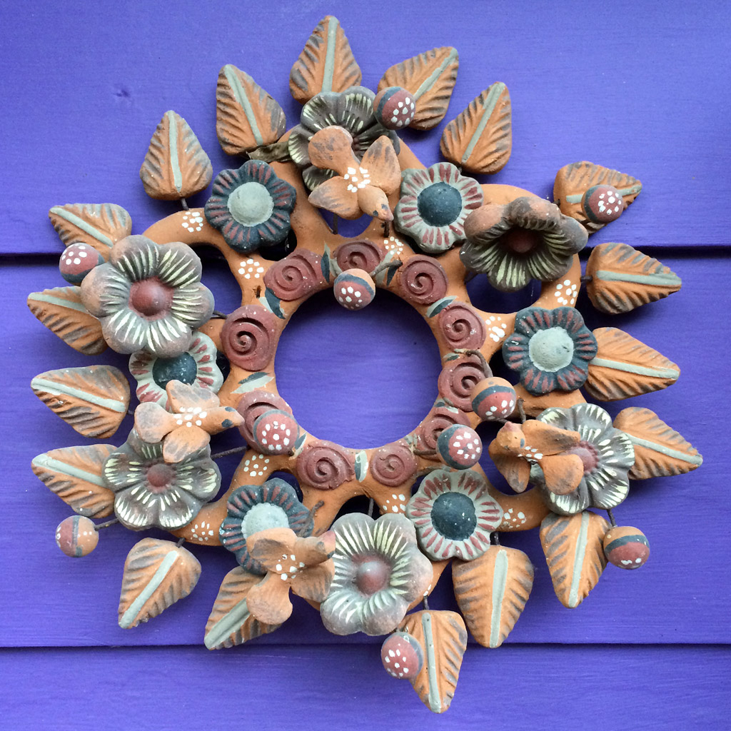 Pottery wall decoration with birds, leaves and flowers