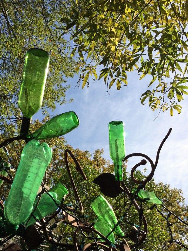 Green bottle tree sconce by Stephanie Dwyer