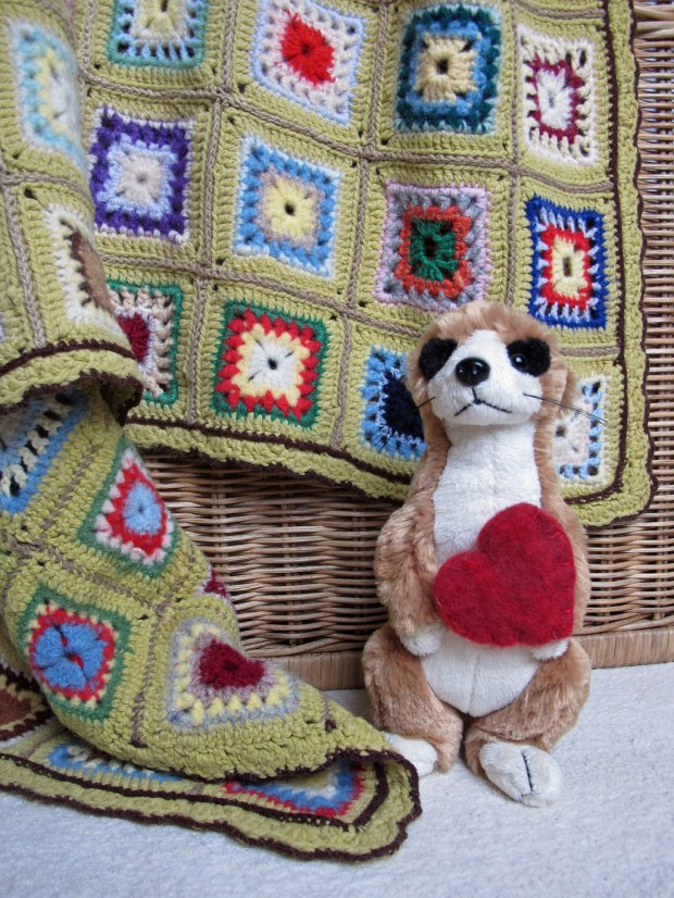 Traditional crocheted throw with meerkat