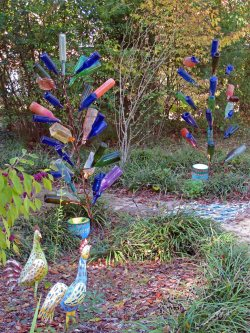 Bottle trees with hand painted uplighters