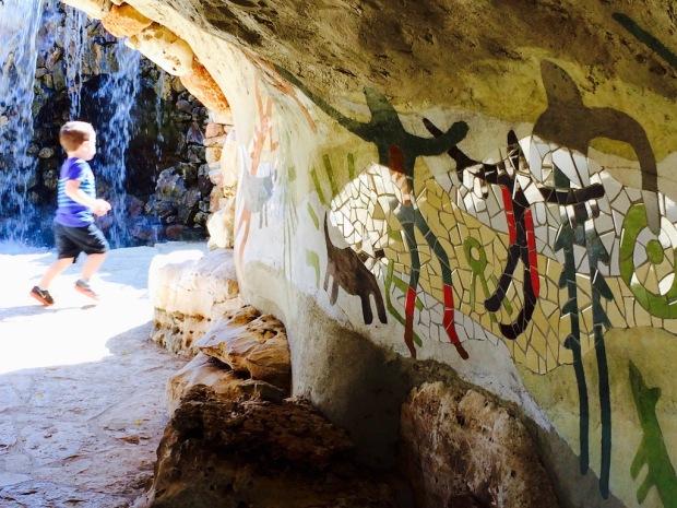 Child Running Through A Grotto