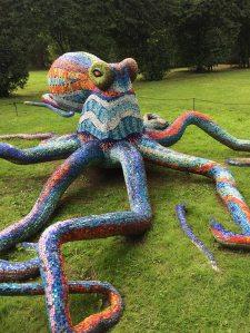 Mosaic octopus sculpture outdoors on the grass
