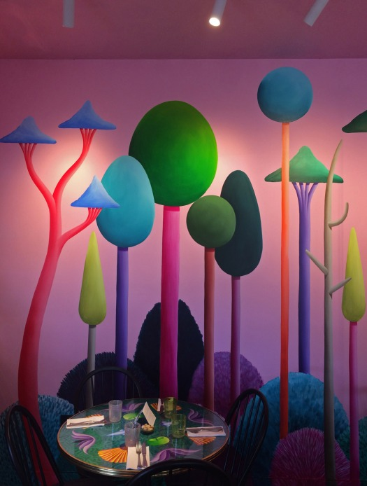 Nicola's Party's naive woodland mural is a colourful backdrop for cafe table