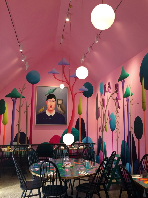 View of the colourful mural and tables at Cafe Party