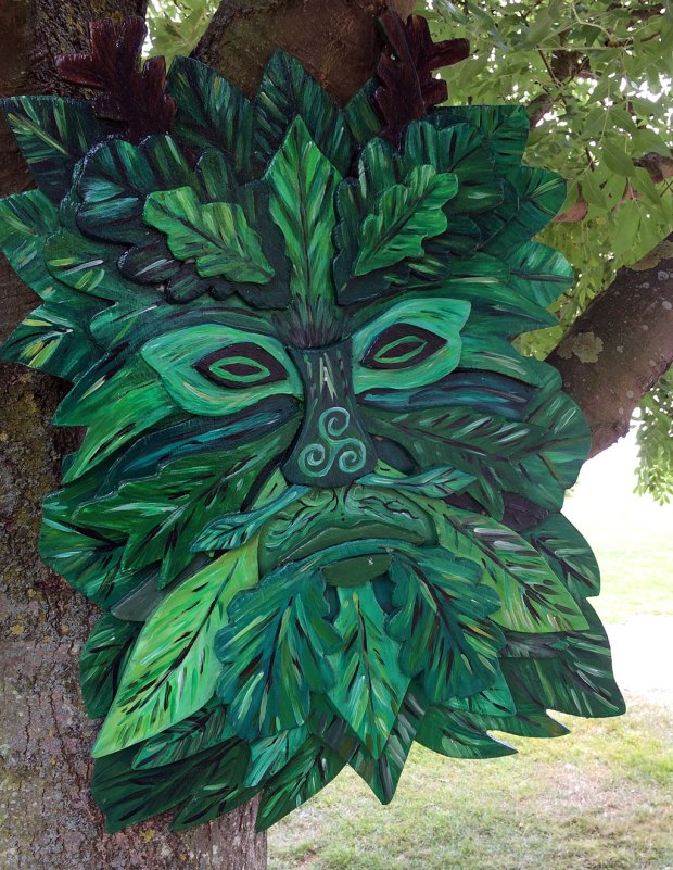 Wooden green man face in a tree