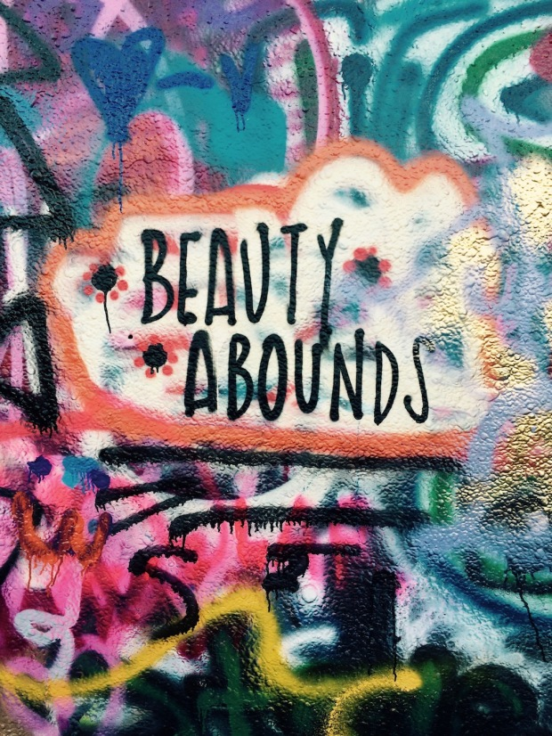 Graffiti around the words: Beauty Abounds