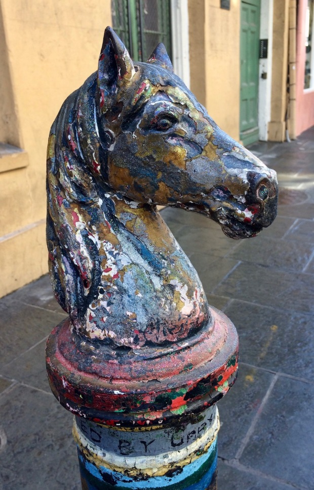 Colourful horse head hitching post