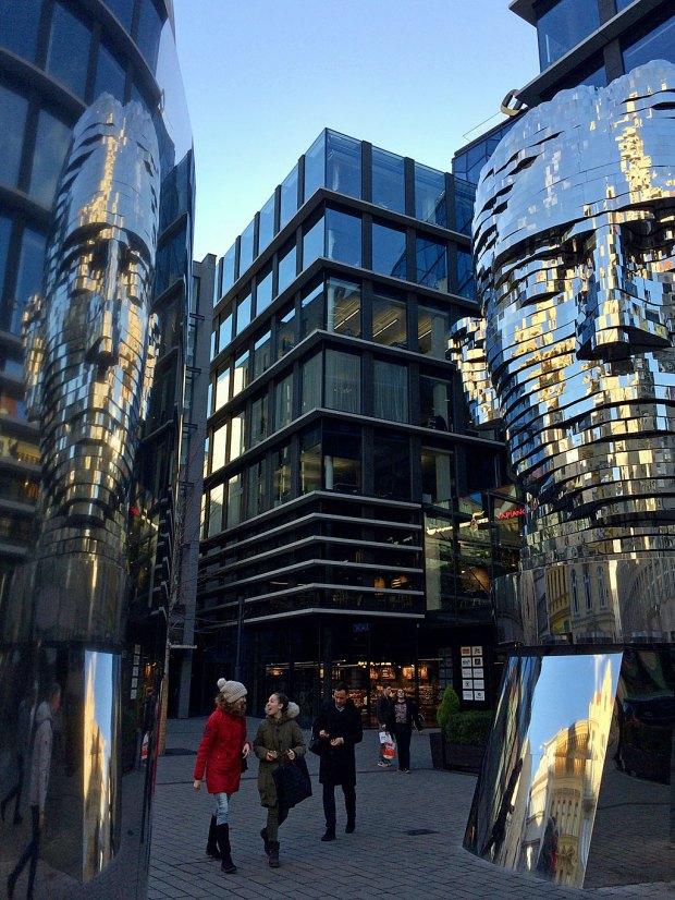 Franz Kafka's head sculpture with reflection