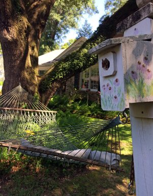 A garden hammock and echinacea design bird house