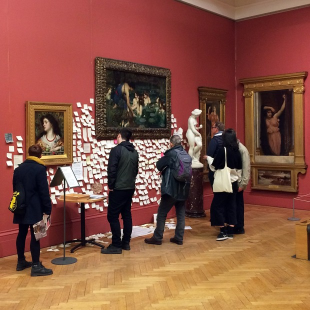 People looking at a Pre-Raphaelite painting with post-it messages