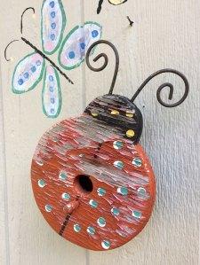 A small birdhouse shaped like a ladybird