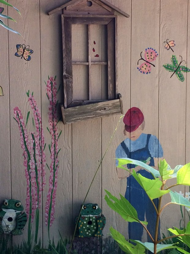 Painting of Peck on the garden outhouse