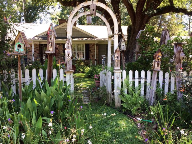 An arched garden entrance in a picket fence
