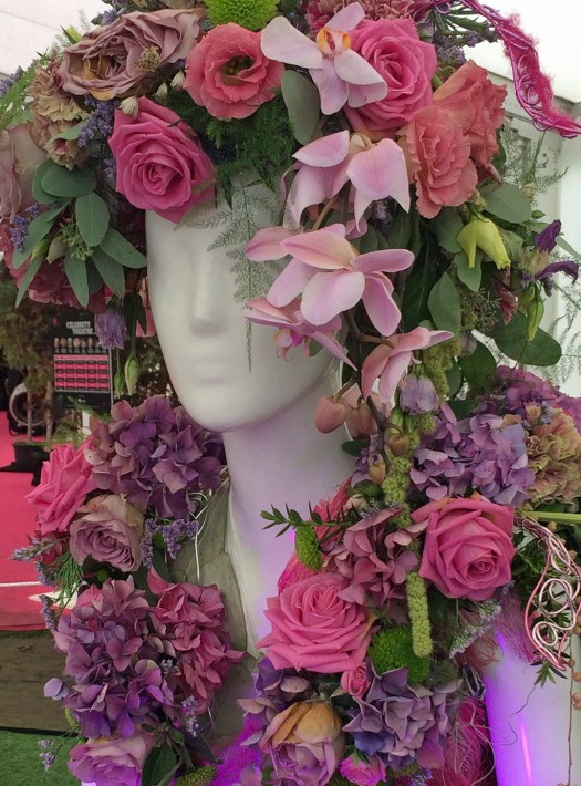 Mannequin with pink roses, lilac hydrangeas and orchids
