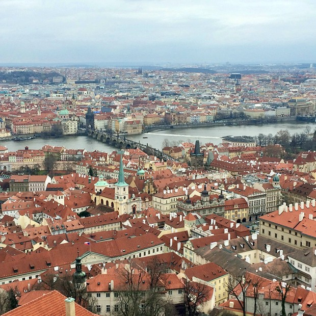 View of Prague's terracotta rooftops and the Vltava River