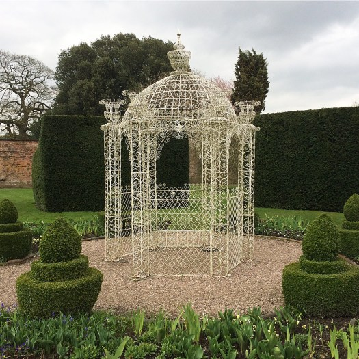 White gazebo with decorative wirework