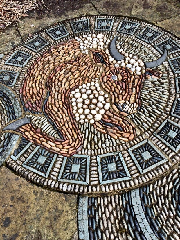 Decorative pebble floor medallion of a bull