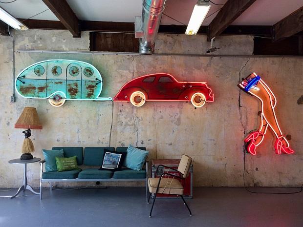 Vintage style neon art in studio: caravan and legs