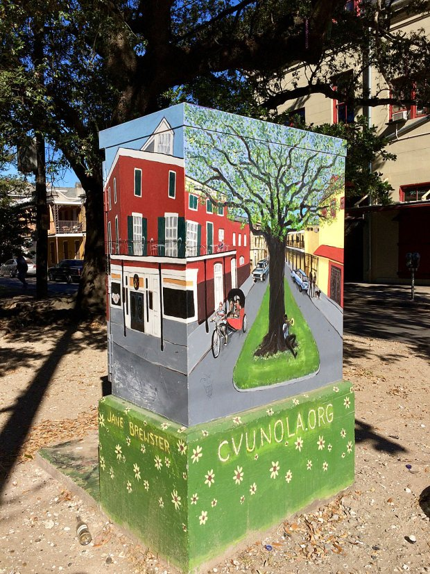 Utility box with painting of tree and street scene