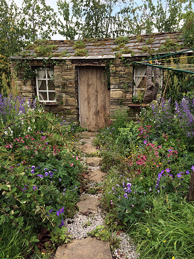 Stone and gravel path through a cottage garden