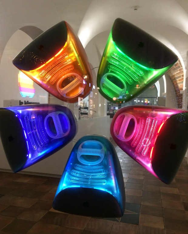 Window display showing five colours of iMacs