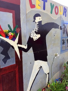 Masked figure with a flower bouquet