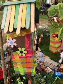 Bird house with ice lolly stick roof, ribbons and flowers