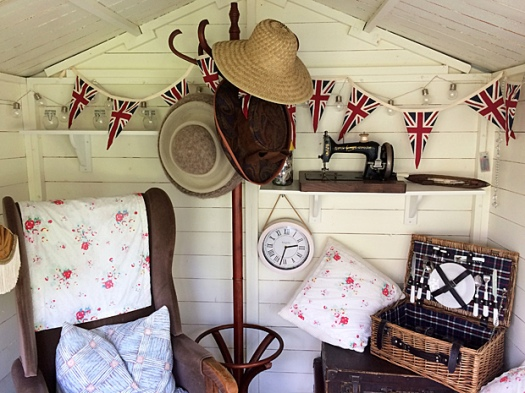 Summer house with chair, picnic hamper and bunting