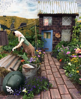 Lady tending a wartime garden