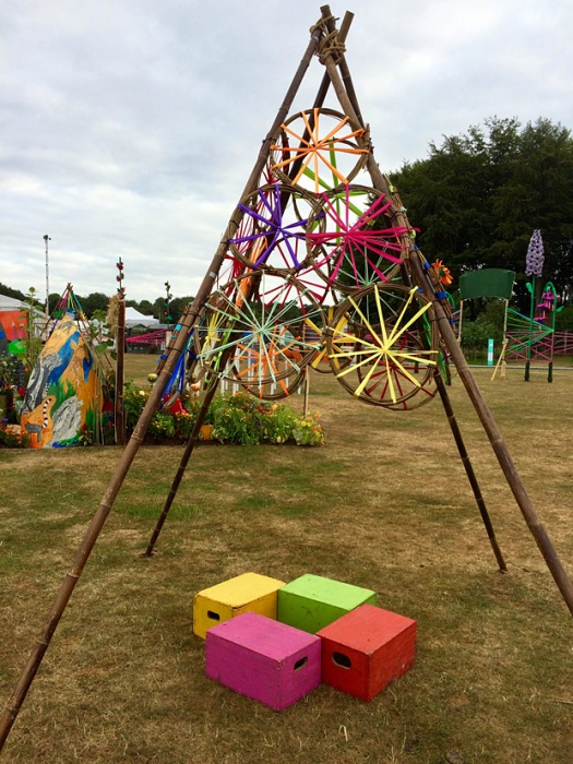 Cane teepee with colourful raffia circles and seating