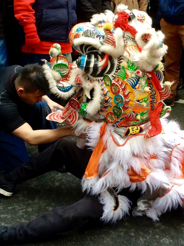 Lion dancer during a pause in the dancing