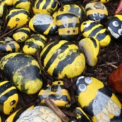 Stones hand painted as bees by children