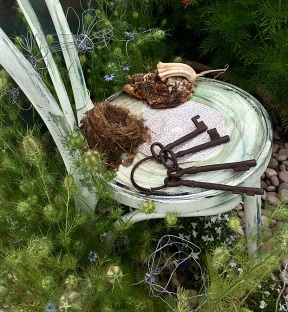Chair with wire flowers, bird nest and large ring of keys