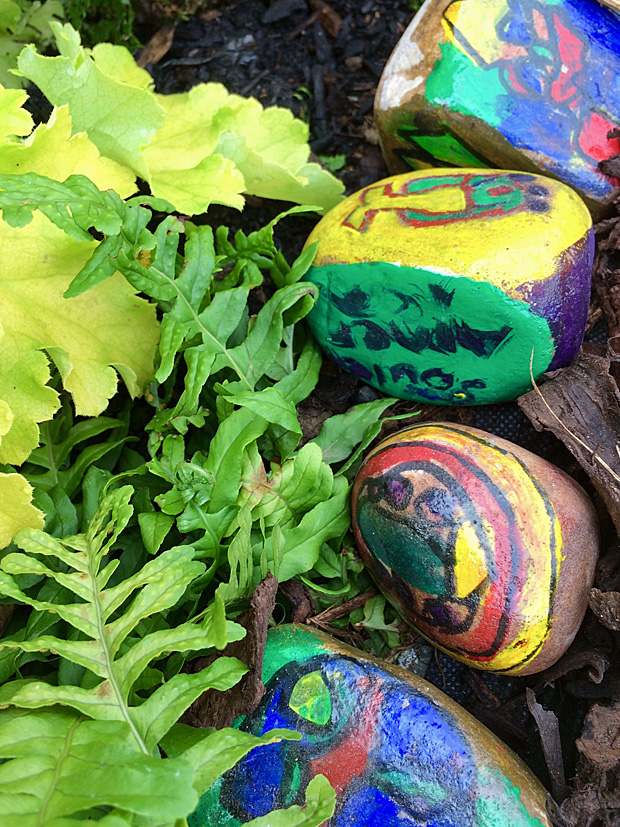 Hand painted stones line a path
