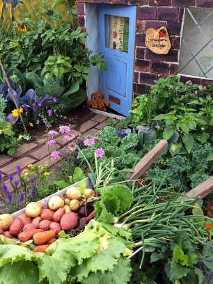 Small wheelbarrow of vegetables
