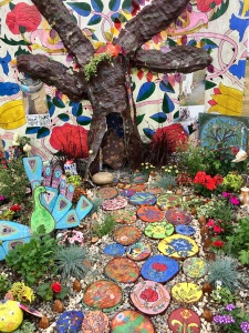 Colourful children's garden with tree trunk path