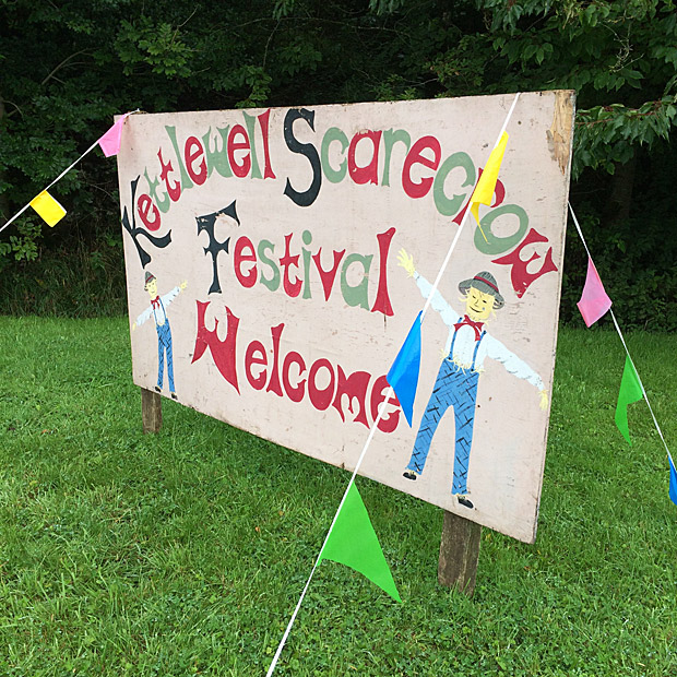 Welcome sign with scarecrows and bunting