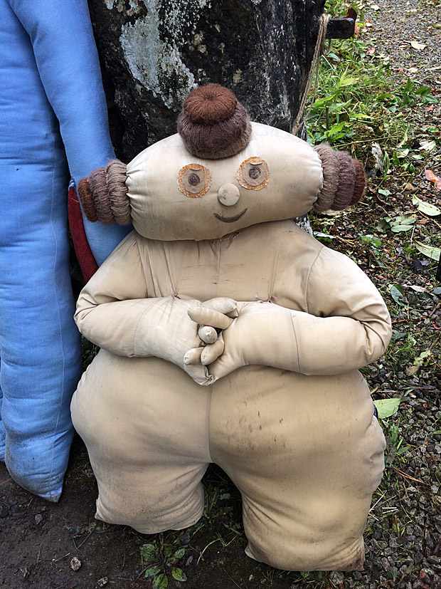 Small, squat figure with coiled hair buns