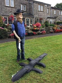 Mick Dundee scarecrow with a tyre crocodile