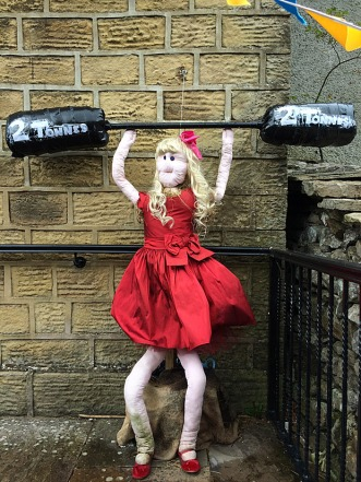 Woman in red party dress lifting weights